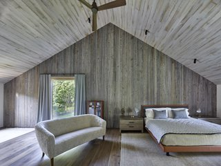 """This Stunning Suffolk County Home Brings a Modern Twist to a Historic Area - Photo 13 of 18 - On the second level, a porch """"cut-out"""" separates the master bedroom from the two children's bedrooms on the opposite end."""