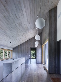 This Stunning Suffolk County Home Brings a Modern Twist to a Historic Area - Photo 4 of 18 - Above is the hallway on the second level of the house.