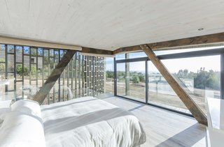 """This """"Almost Cube"""" House Offers Mesmerizing Views of the Chilean Coast - Photo 7 of 12 - A bedroom looks out to stunning coastal views."""