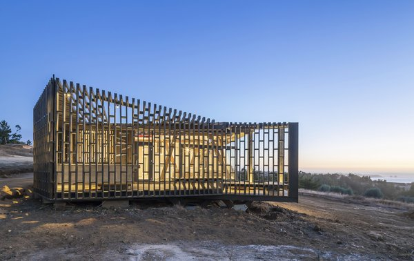 A second skin of made of pinewood and Structural Insulated Panel Ecowall (SIP) shields the outdoor porches of this coastal home.