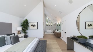 Red Hot Chili Peppers Frontman Anthony Kiedis' Former L.A. Abode Asks $3.2M - Photo 8 of 13 - The master bedroom has a bathroom with a deep soaking tub.