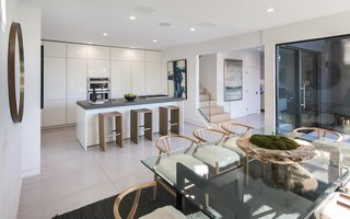Red Hot Chili Peppers Frontman Anthony Kiedis' Former L.A. Abode Asks $3.2M - Photo 10 of 13 - Glass tabletops and stair rails give the interiors a clean, contemporary look.
