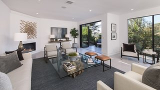 Red Hot Chili Peppers Frontman Anthony Kiedis' Former L.A. Abode Asks $3.2M - Photo 3 of 13 - Retracting walls of glass encourage indoor/outdoor living.