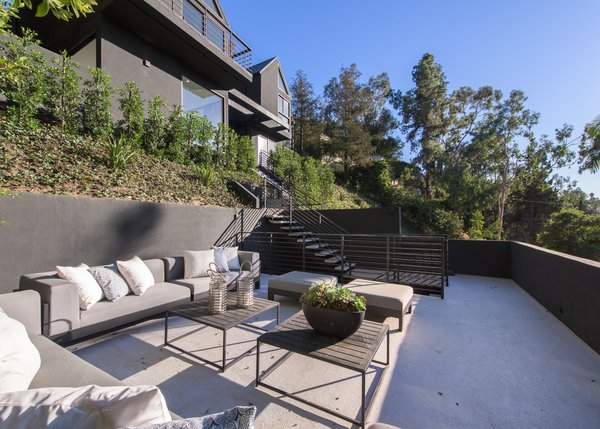 An outdoor terrace lounge on the slope of the property.