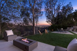 Red Hot Chili Peppers Frontman Anthony Kiedis' Former L.A. Abode Asks $3.2M - Photo 12 of 13 - A stacked-stone fire pit and spectacular canyon views encourage outdoor living.