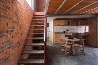 Before and After: A Cramped Home in Mexico Gets a Drastic Makeover on a Tight Budget - Photo 11 of 18 - A simple material palette of brick, concrete, tiles, and wood gives the home a warm, contemporary atmosphere.