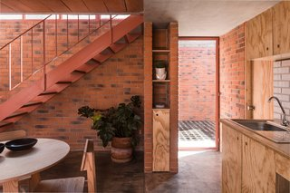 Before and After: A Cramped Home in Mexico Gets a Drastic Makeover on a Tight Budget - Photo 12 of 18 - Light enters the kitchen from the courtyard through one of the glass doors.
