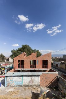 Before and After: A Cramped Home in Mexico Gets a Drastic Makeover on a Tight Budget - Photo 6 of 18 - The balcony on the upper level looks down towards the courtyard.