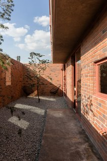 Before and After: A Cramped Home in Mexico Gets a Drastic Makeover on a Tight Budget - Photo 13 of 18 - The courtyards provide the family with private outdoor zones.