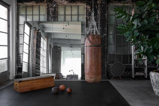 A 1920s Office Space Is Transformed Into a Polished Penthouse - Photo 4 of 13 - An at-home gym was also designed as part of the renovation.