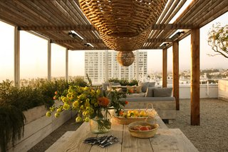 A 1920s Office Space Is Transformed Into a Polished Penthouse - Photo 11 of 13 - The terrace area features a reed and metal pergola structure designed by PSS Design Cult.