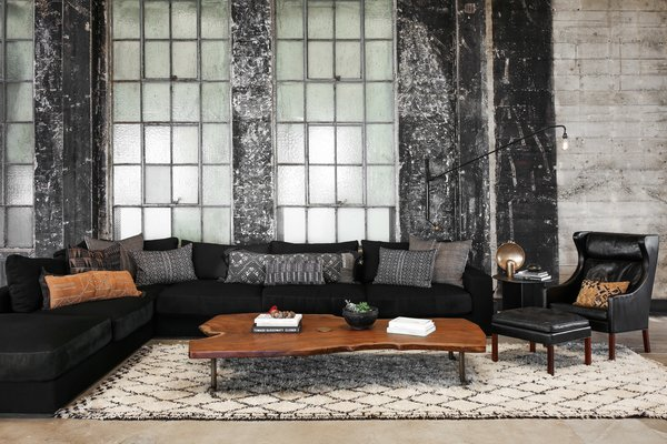 A custom bleached walnut live edge slab coffee table by Alexander Design and Spark and dowel,  sofa and cushions by Alexander Design, and an Illum Wikkelsø armchair.