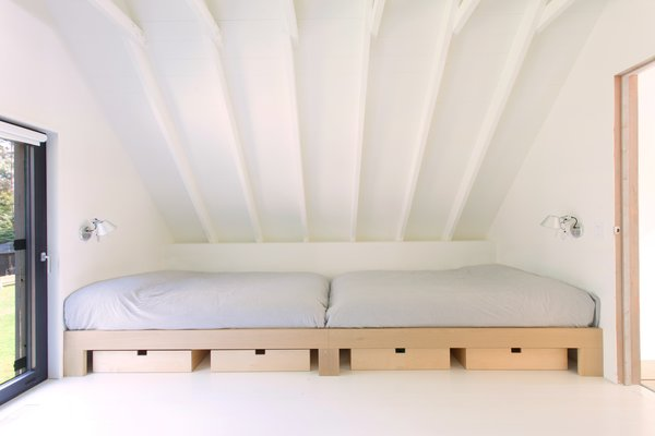 Two beds in the dormitory on the upper level.