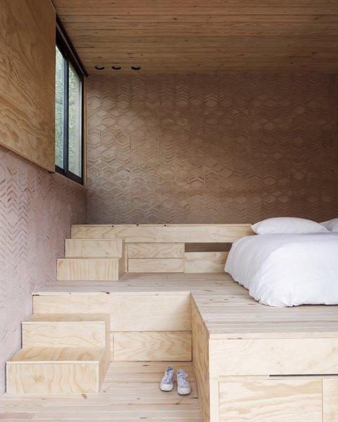 A raised platform allows for understairs storage.