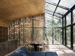 A Mirrored Mexican Home Hides Among a Lush Forest - Photo 6 of 15 - The back wall, as well as part of the roof, is fitted with plywood sheathing.
