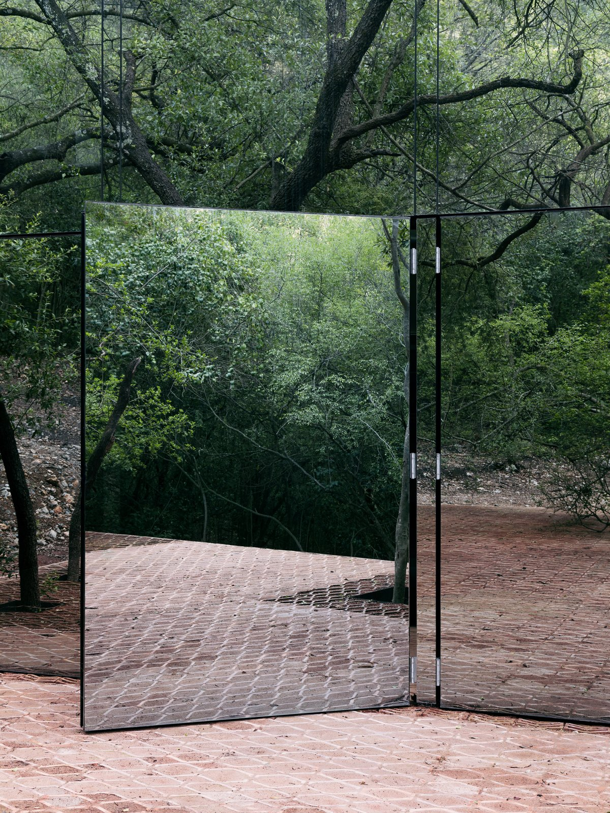 The door to the social zones swing open to connect to the terrace. Tagged: Doors, Exterior, and Swing.  Best Doors Photos from A Mirrored Mexican Home Hides Among a Lush Forest