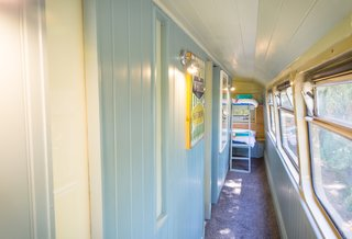 This Double-Decker Bus Offers an Eclectic Glamping Experience - Photo 7 of 12 - Two bunk beds are located on the upper deck of the bus.