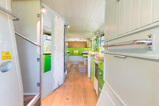 This Double-Decker Bus Offers an Eclectic Glamping Experience - Photo 3 of 12 - The kitchen and bathroom sit along the corridor of the lower level.