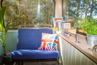 This Double-Decker Bus Offers an Eclectic Glamping Experience - Photo 9 of 12 - Details such as the Union Jack cushion give the interior a cool, vintage-inspired British vibe.