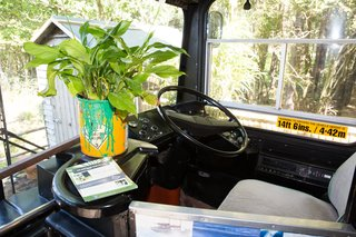This Double-Decker Bus Offers an Eclectic Glamping Experience - Photo 10 of 12 - The original driver's seat and steering wheel were kept intact during the renovation.