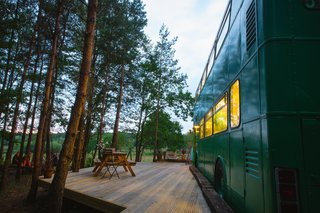 """This Double-Decker Bus Offers an Eclectic Glamping Experience - Photo 11 of 12 - The bus stays """"parked"""" in a peaceful wooded site in the Sussex countryside."""