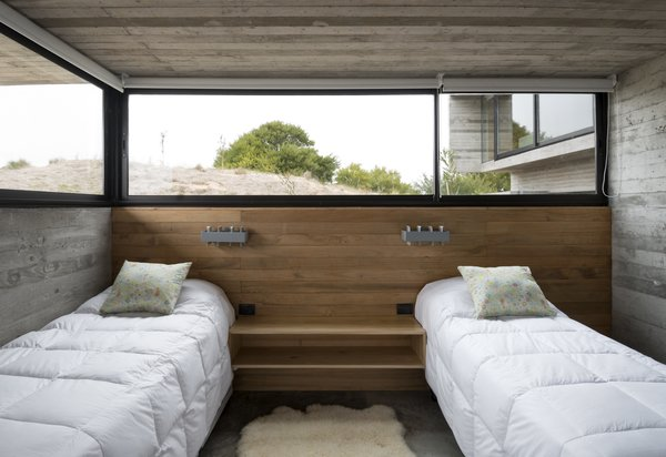 A guest bedroom that's partially submerged in the dunes.