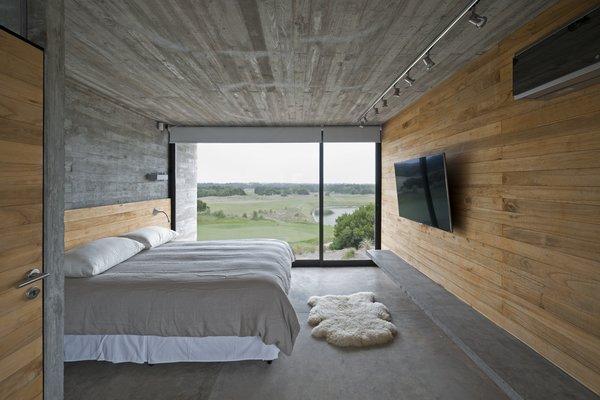 Kiri wood walls help keep the bedroom cool.