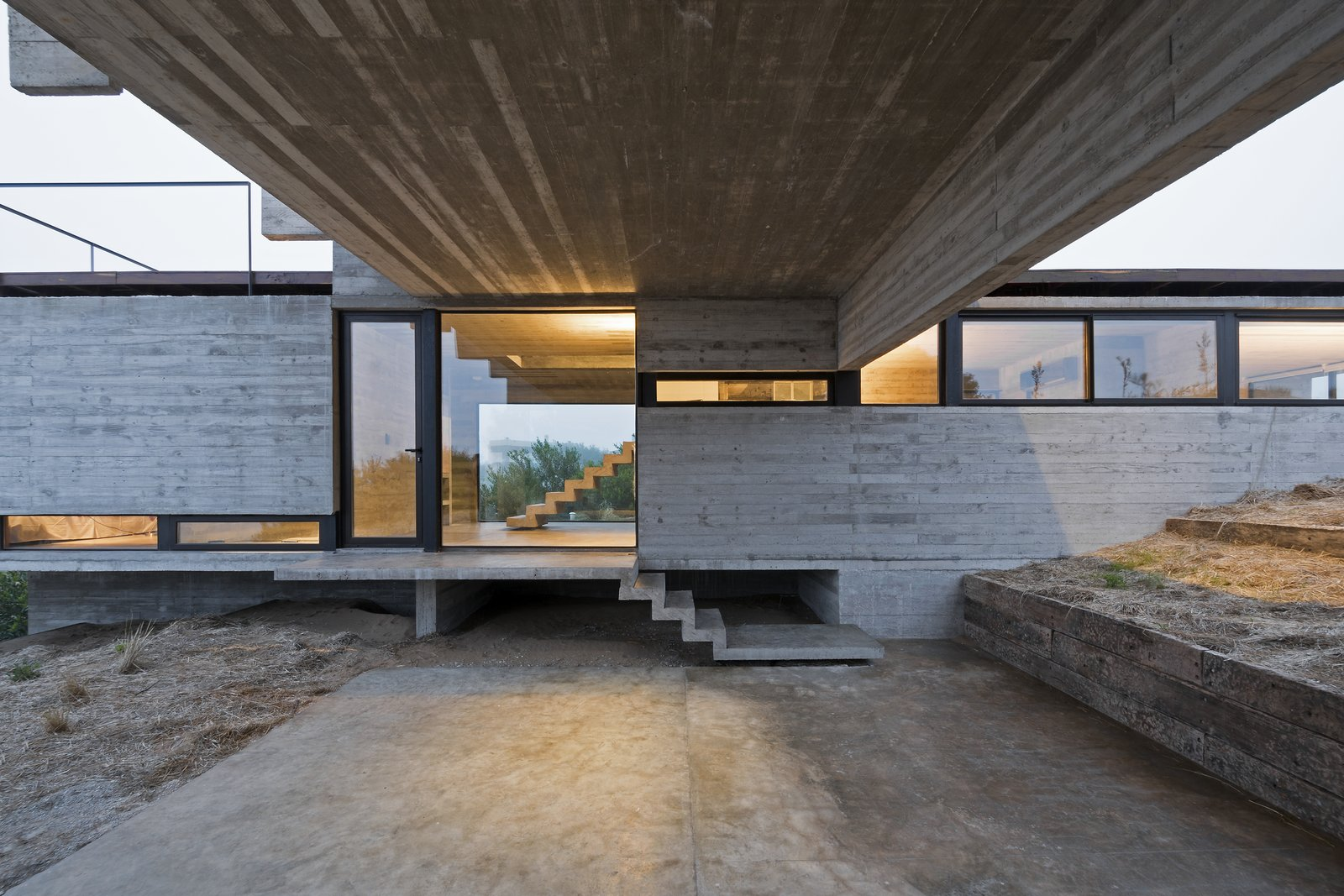 The varied heights of the volumes create interesting interior perspectives. Tagged: Garage.  Best Photos from This Stacked Concrete Home Is Not Your Typical Golf Course Dwelling