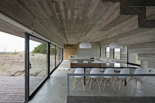This Stacked Concrete Home Is Not Your Typical Golf Course Dwelling - Photo 8 of 17 - The dining area connects to an expansive viewing terrace.