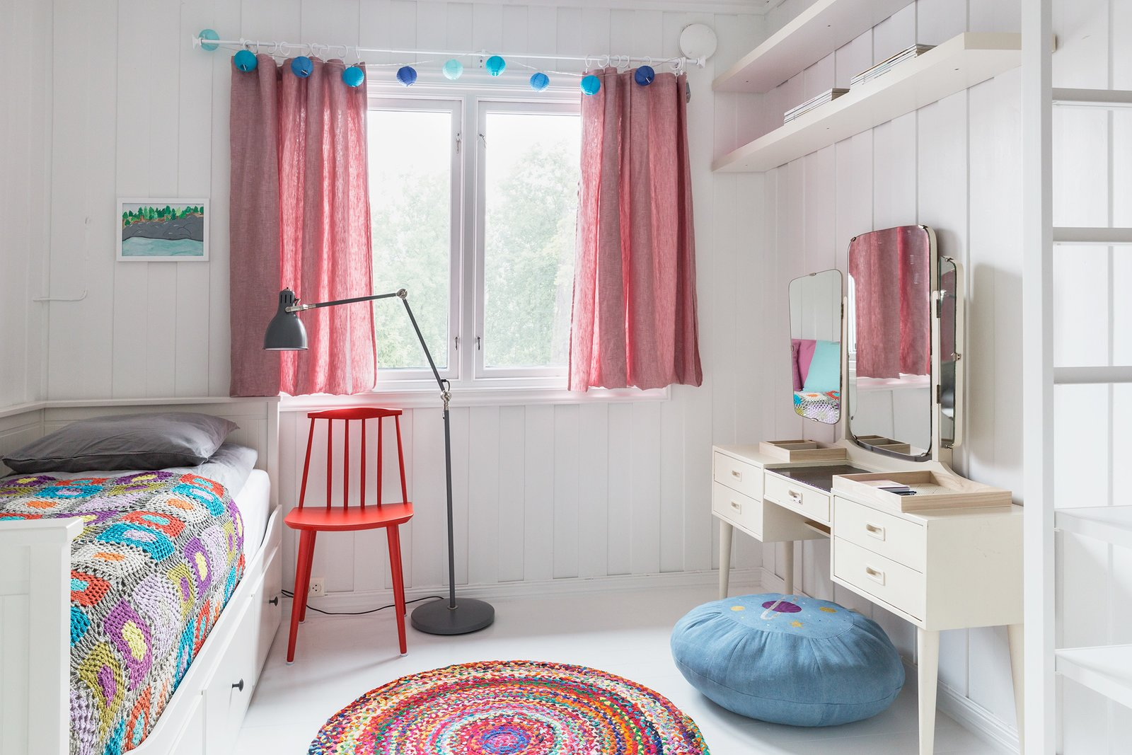 Colorful bed spreads and rugs make this a cool bedroom for kids.