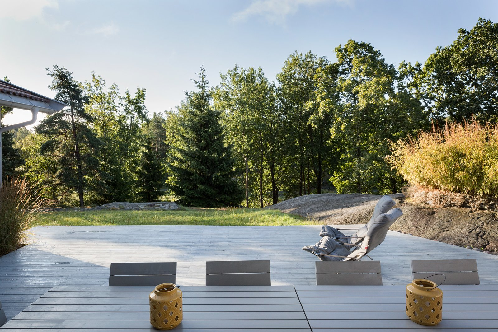 The large outdoor terrace surrounded by trees.