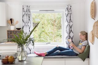 "Relax and Recharge at This Charming Norwegian ""Hytte"" Rental - Photo 6 of 13 - A reading bench next to the kitchen counter."