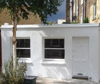 This Tiny 140-Square-Foot Apartment Boasts Comfort and Function - Photo 1 of 15 - The exterior of the compact 140-square-foot micro-apartment in north London.