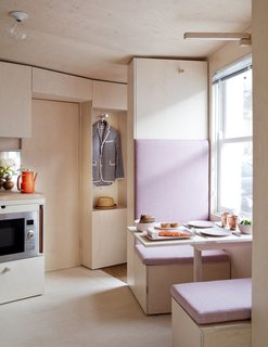 This Tiny 140-Square-Foot Apartment Boasts Comfort and Function - Photo 12 of 15 - A breakfast booth that looks out to the street.