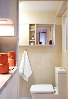 This Tiny 140-Square-Foot Apartment Boasts Comfort and Function - Photo 10 of 15 - The bathroom, which is located behind the kitchen, is the only space that's separated by a wall.
