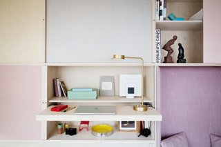 This Tiny 140-Square-Foot Apartment Boasts Comfort and Function - Photo 5 of 15 - Technical equipment is hidden below this furniture unit.