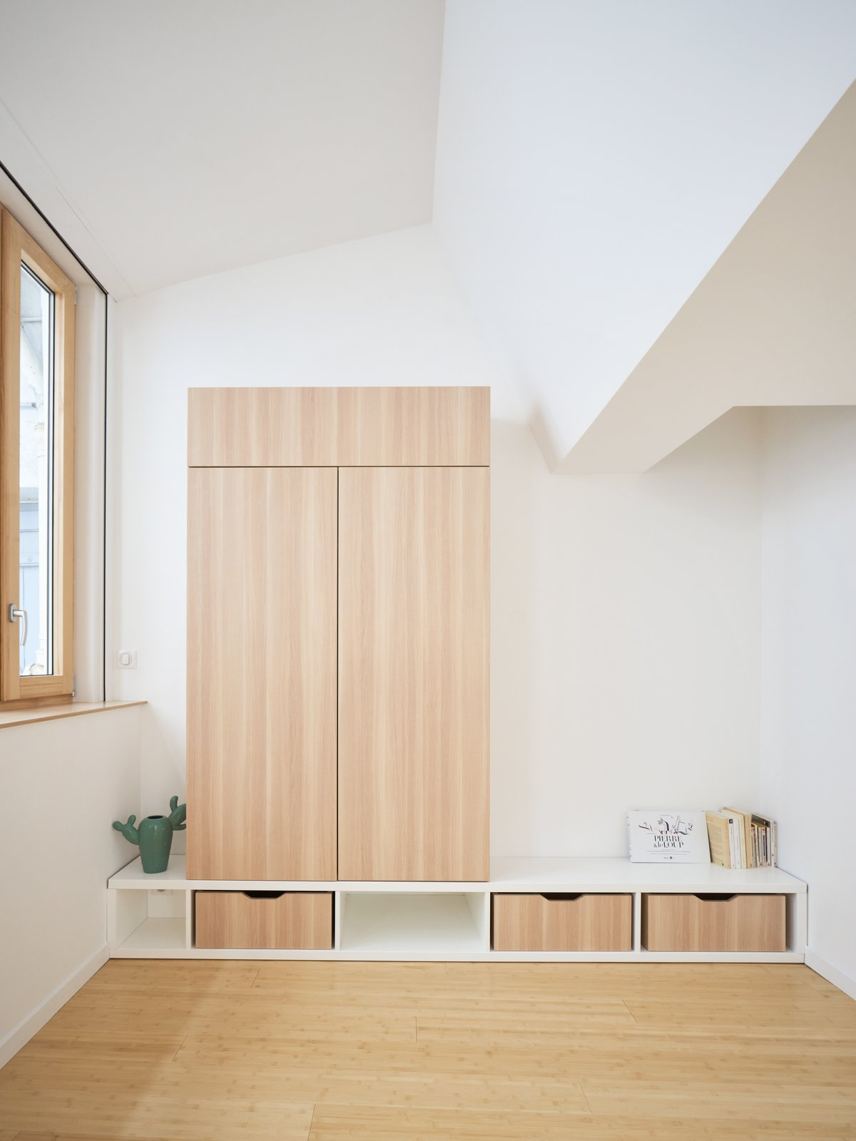 A discreet built-in wardrobe in the bedroom.