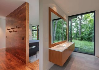 """This Glass House and """"Shiny Shed"""" Merge With Nature in Minnesota - Photo 10 of 15 - The bathroom has a large window that frames tree views."""