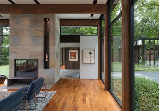 """This Glass House and """"Shiny Shed"""" Merge With Nature in Minnesota - Photo 3 of 15 - Here's a look at the entry to a corridor that leads to the bedroom wing."""