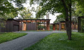 """This Glass House and """"Shiny Shed"""" Merge With Nature in Minnesota - Photo 1 of 15 - Plenty of natural light is brought into the home thanks to the high glazed walls."""