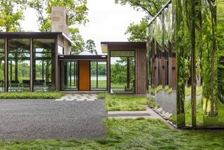 "This Glass House and ""Shiny Shed"" Merge With Nature in Minnesota"