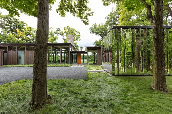 The mirror-clad shed gives the property a sense of constant movement.