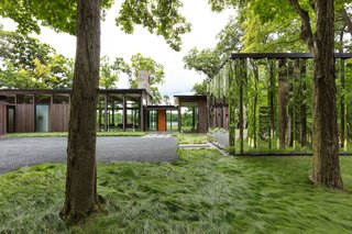 """This Glass House and """"Shiny Shed"""" Merge With Nature in Minnesota - Photo 12 of 15 - The mirror-clad shed gives the property a sense of constant movement."""