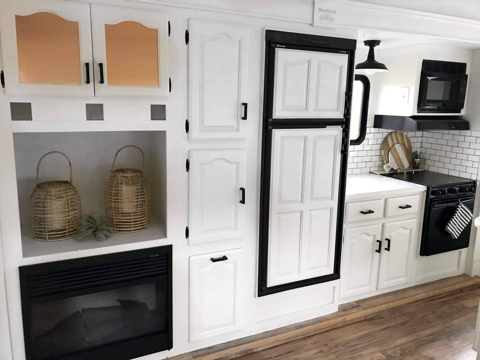 The kitchen has a fireplace, oven, microwave, electric cooktop and plenty of discreet storage.