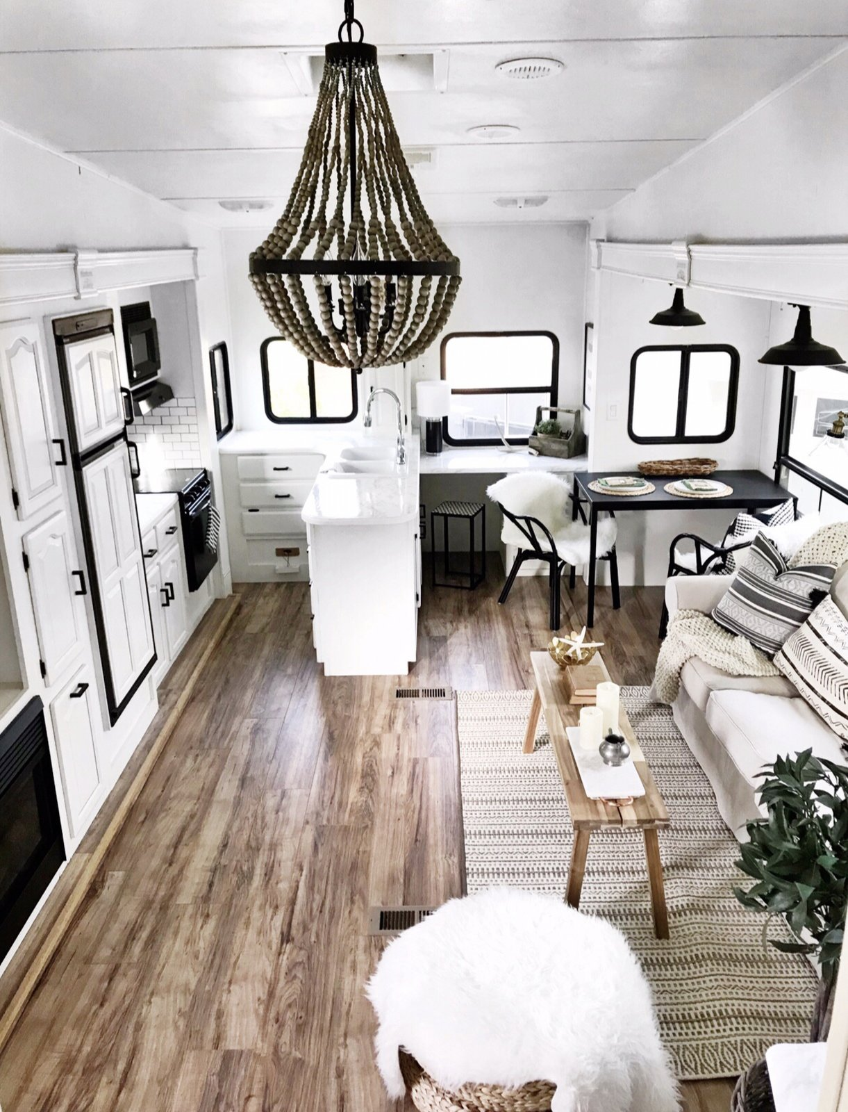 Wood details and a simple white and black color scheme give the RV's interior a bright, modern Scandinavian feel.