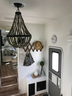 Hit the Road With This Chic Camper on Sale For $28K - Photo 6 of 15 - The Sholin's used Smartcore wood-effect vinyl floors in Tahitian Walnut for the new flooring.