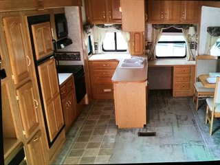 Hit the Road With This Chic Camper on Sale For $28K - Photo 2 of 15 - The kitchen before the renovation.