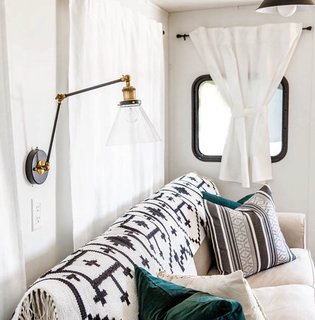 Hit the Road With This Chic Camper on Sale For $28K - Photo 7 of 15 - This LNC Plug-in Wall Lamp with a swing arm is from World Market.