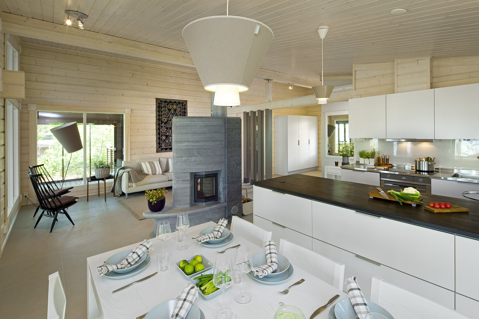 This model has vaulted ceilings and an glass-encased outdoor area with a large overhanging roof.