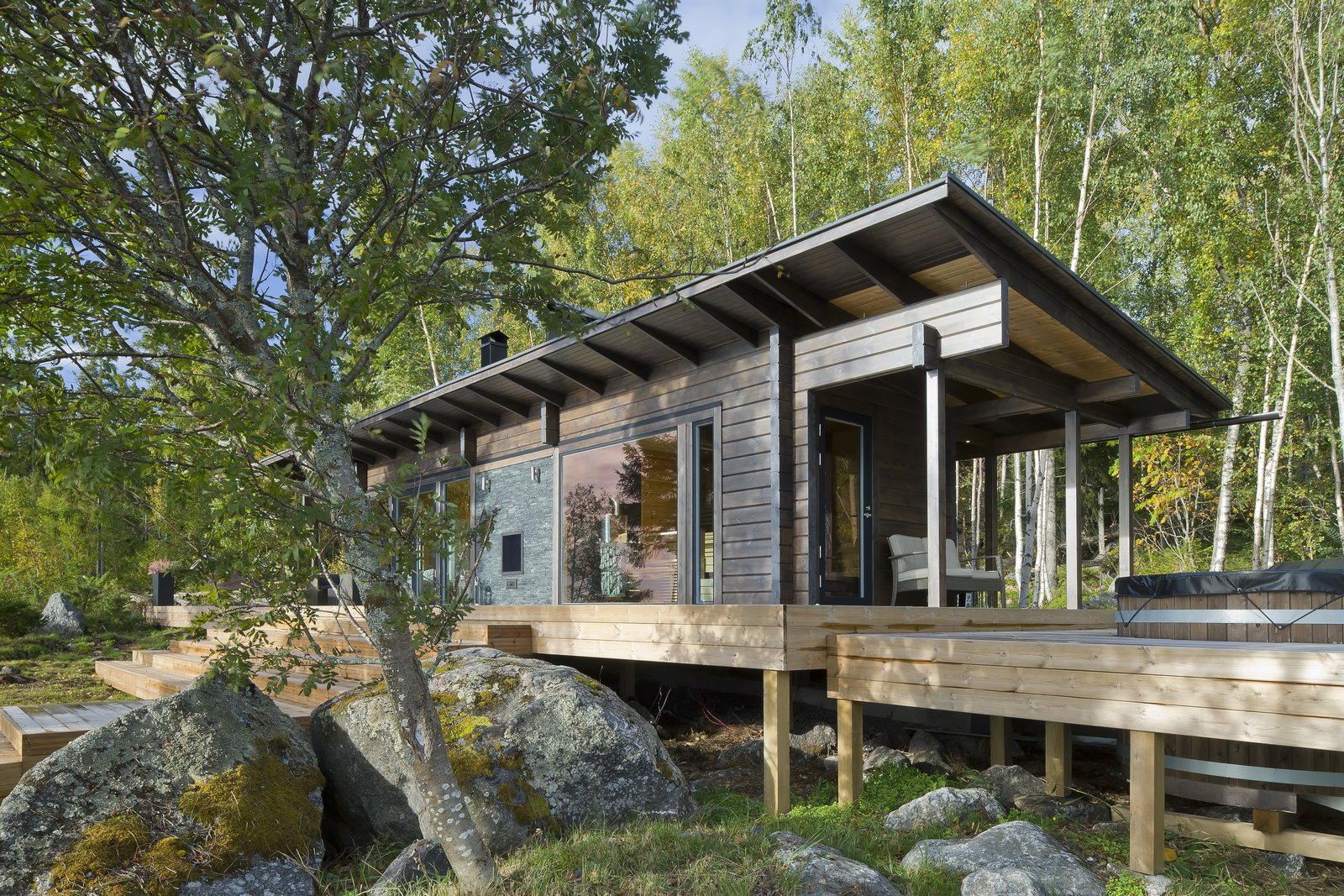 This wilderness sauna cabin in the west coast of Finland was built with 112-millimeter thick squrae logs, and has a 1,028-square-foot outdoor terrace.